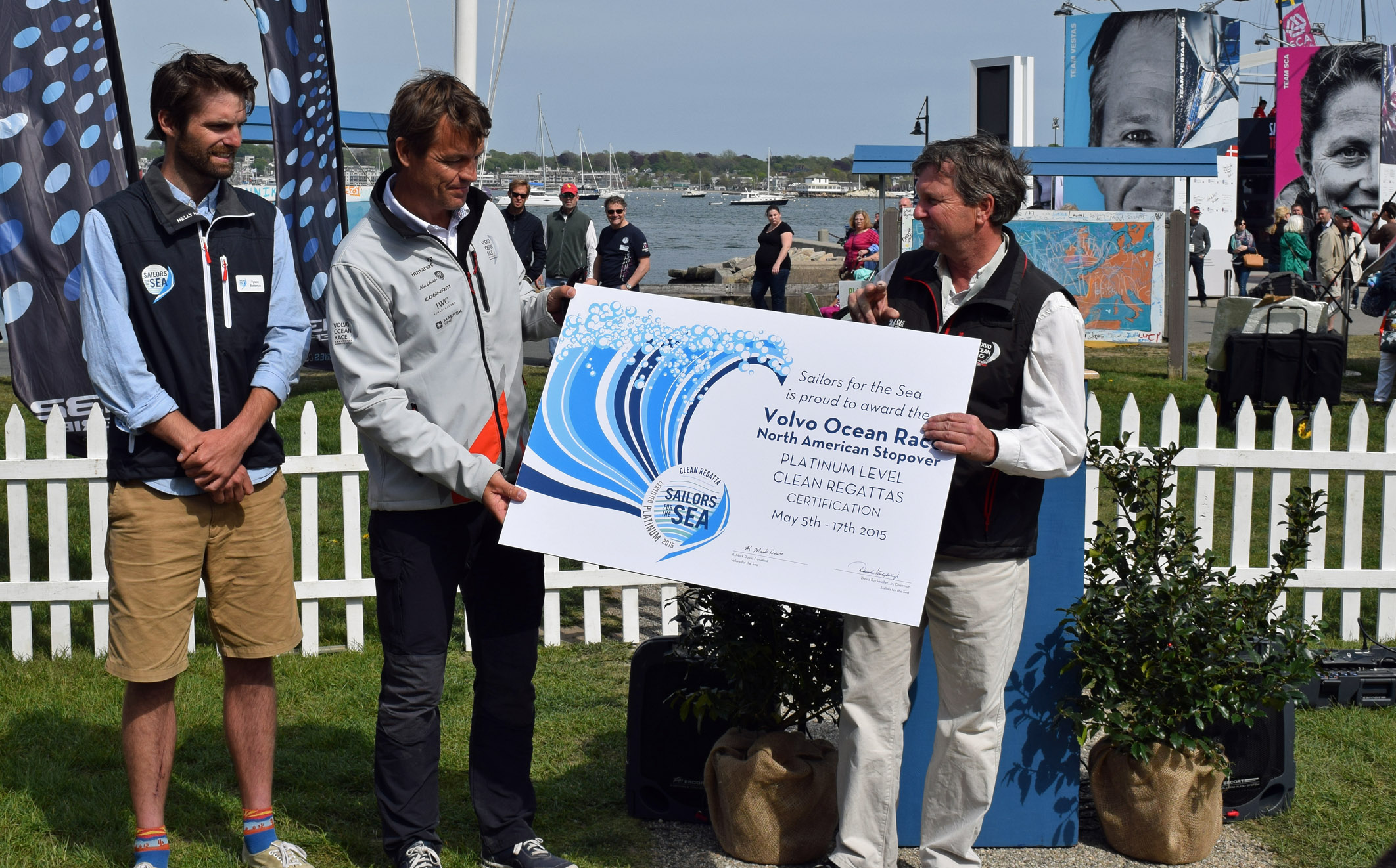 Tyson Bottenus awards the Platinum Level Clean Regattas Certification to the Knut Frostad, CEO of the Volvo Ocean Race and Brad Read, Executive Director of Sail Newport.