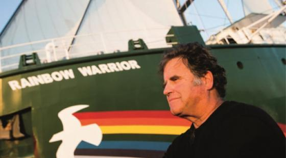 Captain Peter Willcox of Greenpeace with the Rainbow Warrior.
